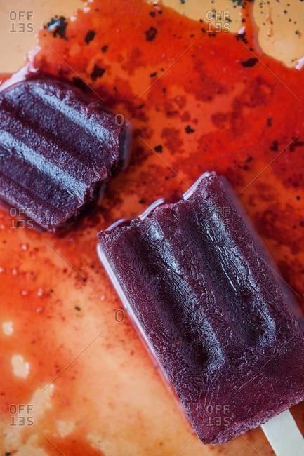 Homemade fruit ice pops melting