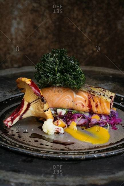 Organic salmon with cider and red wine glaze, chanterelle and medley of fall vegetables