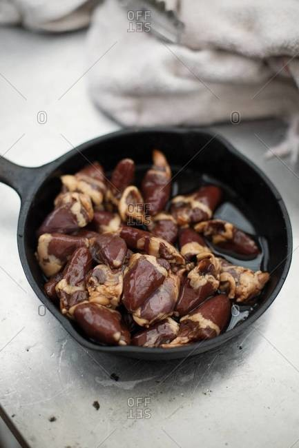 Chicken hearts prepared in skillet for cooking
