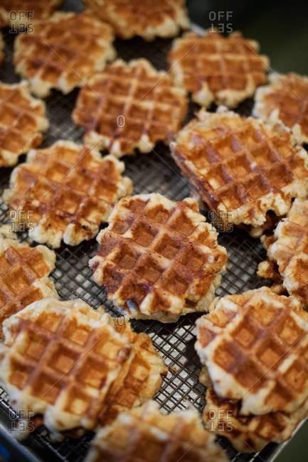Fresh Belgian waffles on baking rack