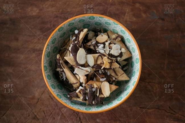 Bowl of almond and chocolate snacks