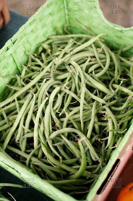 Box of green beans on market