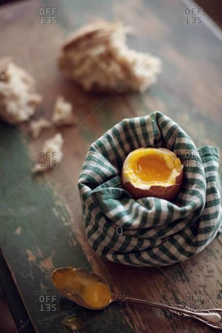 Eating boiled egg for breakfast