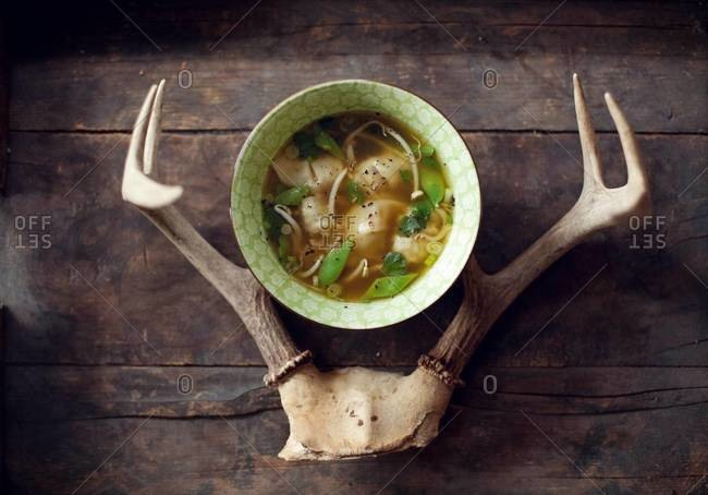 Soup with wontons served in interior