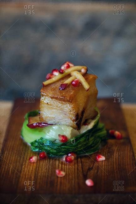 Seared pork belly with vanilla bok choy, celery root puree and pomegranate
