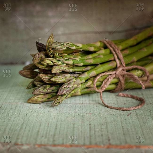 Bunch of asparagus displayed on table