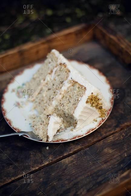 Piece of honey vanilla buttercream pistachio cake