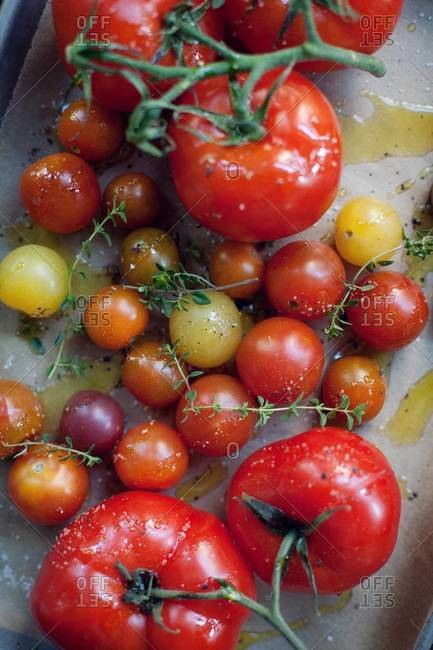 Top view of various tomato on parchment paper