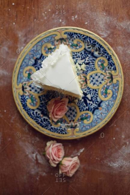 Piece of wedding cake served on plate