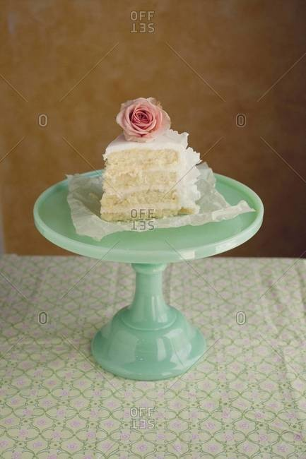 Piece of wedding cake served on cake stand
