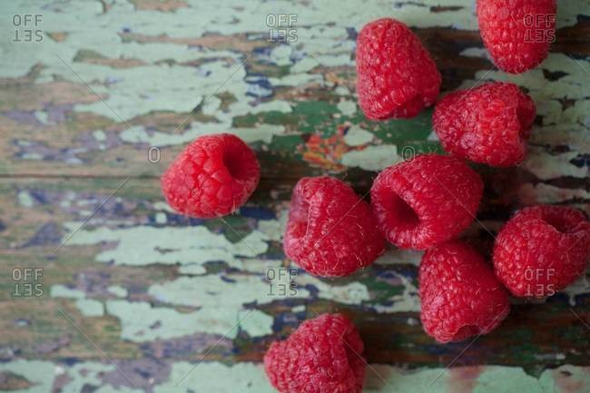 Raspberries displayed on wooden table