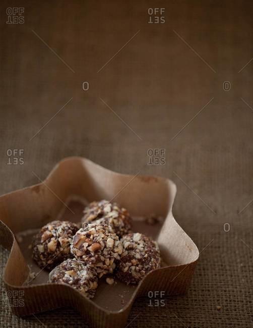 Hazelnut truffles served in paper plate