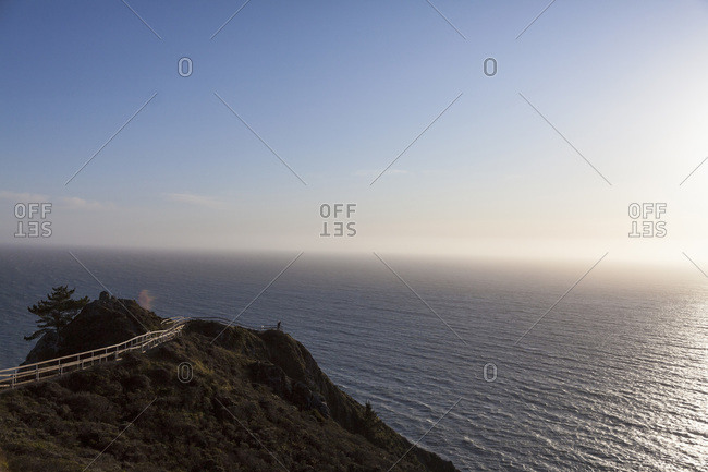 Person admiring view of ocean from Observation Point, USA