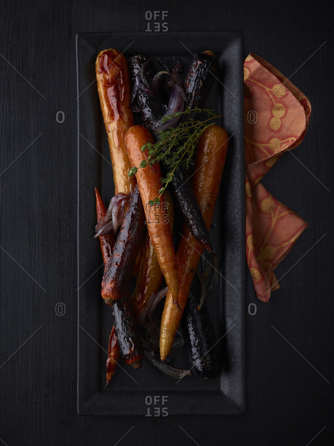 Overhead view of plate of grilled carrots