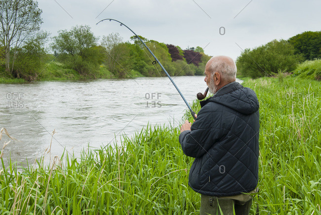 Man fishing at river Nore, Thomastown, County Kilkenny, Leinster, Republic of Ireland