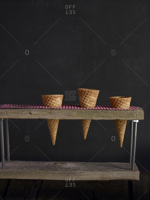Waffle cones in ice cream cone stand