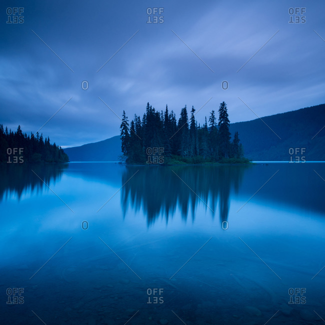 View of small island in the middle of a lake, Yukon Territory, Canada