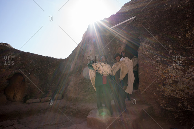 Lalibela, Ethiopia - January 4, 2014: Pilgrims standing in the entrance of rock-hewn building in Lalibela, Ethiopia