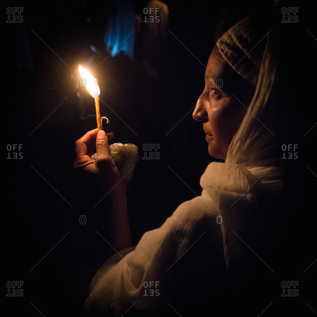 Lalibela, Ethiopia - January 6, 2014: Lalibela, Ethiopia - January 6, 2014: Side view of woman celebrating Ethiopian Orthodox Christmas in Lalibela, Ethiopia