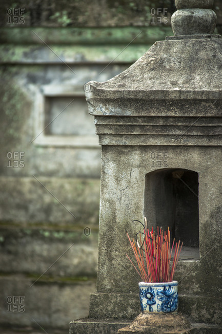 Incense sticks at an ancient tomb at Hoa Yen pagoda, Vietnam