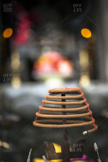 Incense coil burning at a shrine in Vietnam