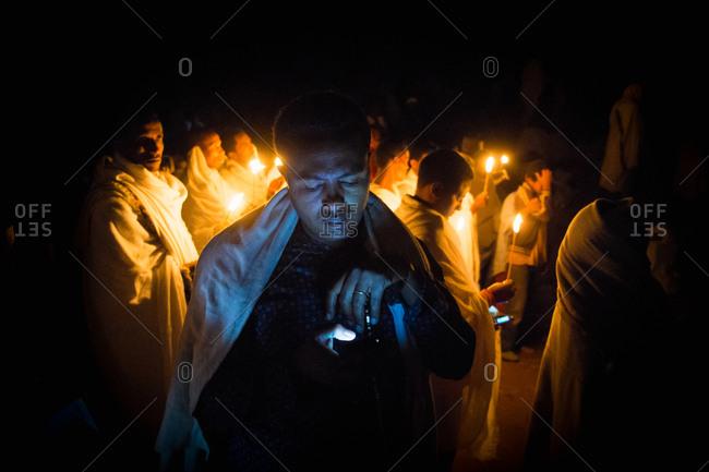 Lalibela, Ethiopia - January 6, 2014: Pilgrims and priests celebrate Ethiopian Orthodox Christmas in Lalibela, Ethiopia