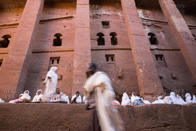 Lalibela, Ethiopia - January 6, 2014: Pilgrims waiting in front of Bete Giyorgis church, in Lalibela, Ethiopia