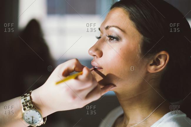 Make up artist applying a bridal make up