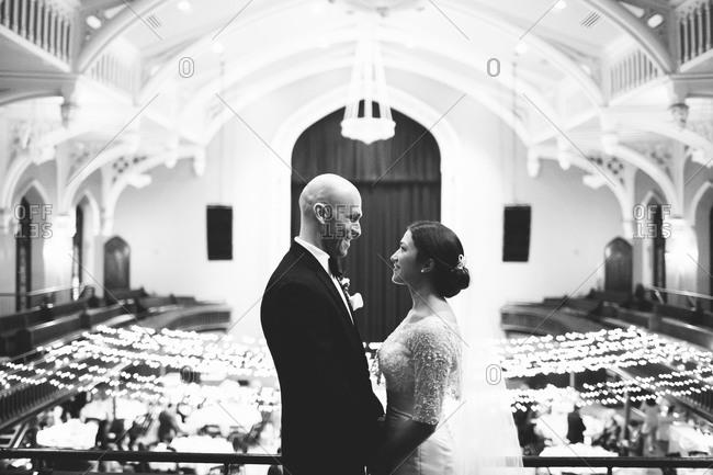 Wedding couple posing on balcony during wedding reception