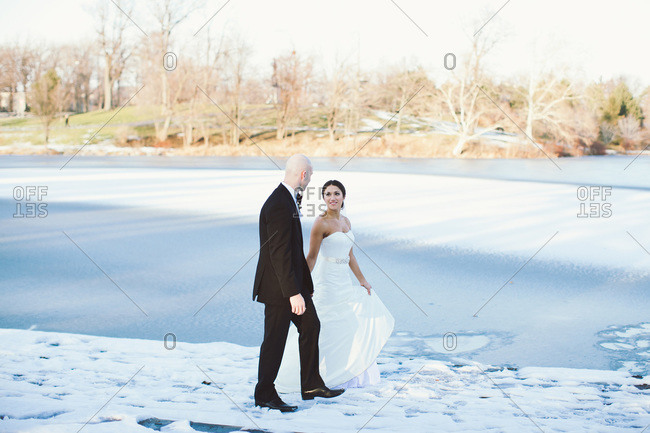 Newlyweds walking in the snow