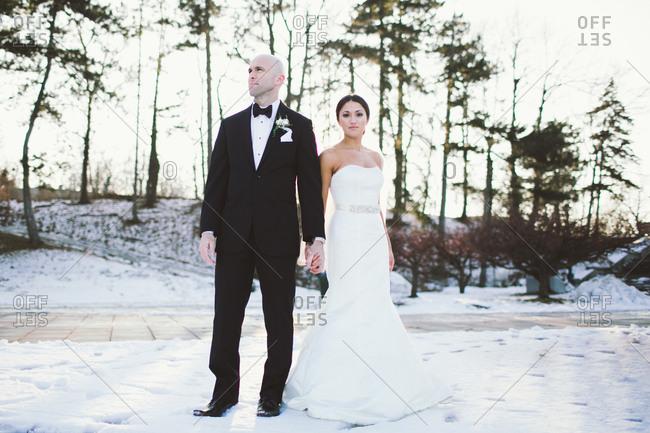 Newlyweds posing on the street