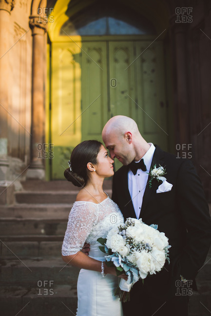 Newlyweds posing on the street