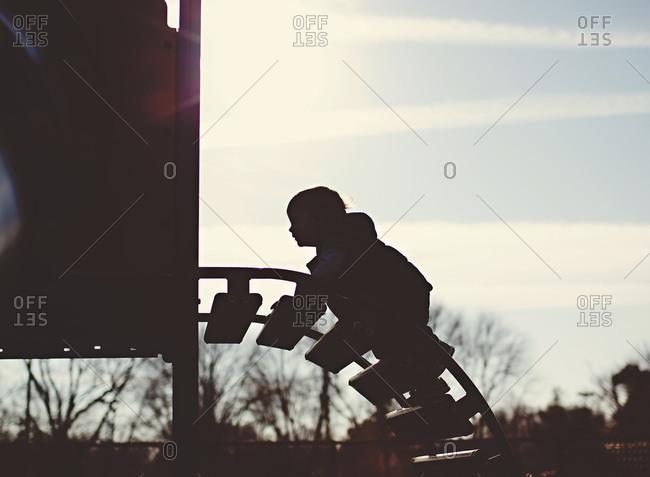 Child climbs on playground