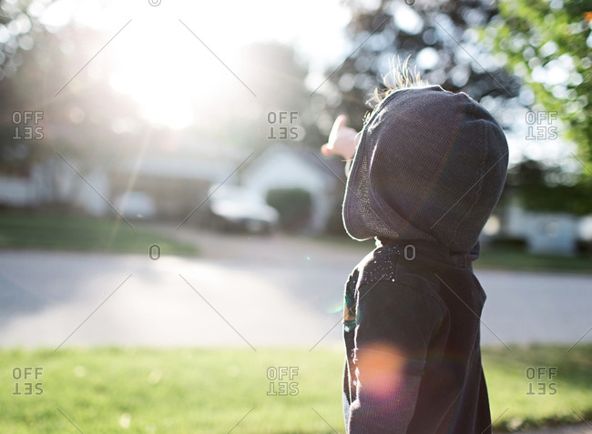 Child points at sunshine