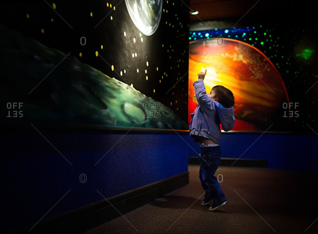 Child points at planet
