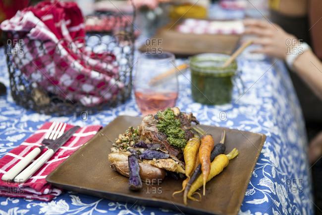 Lamb chops served with vegetables on al fresco diner