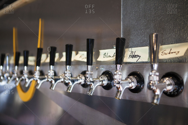 Stainless steel beer taps in row