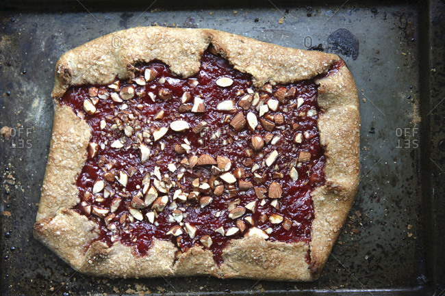 Rhubarb crostata sprinkled with almonds