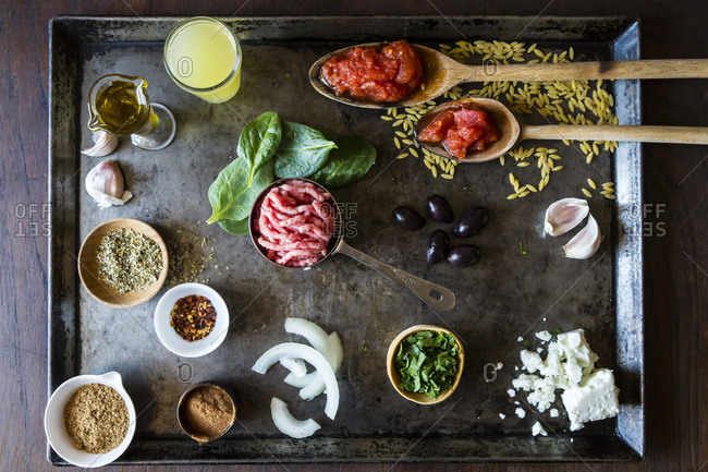Overhead view of Greek lamb with orzo with various ingredients