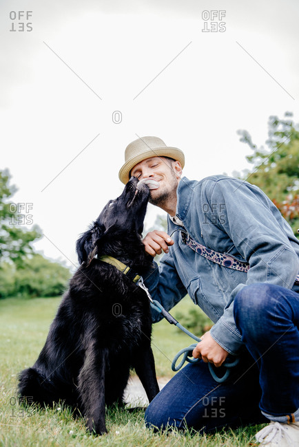 Dog licking his owners face