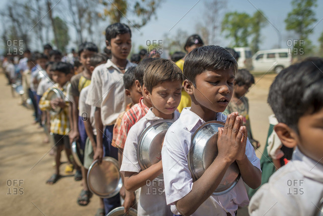 April 11, 2012: Orphans pray before lunch at an orphanage in Central India