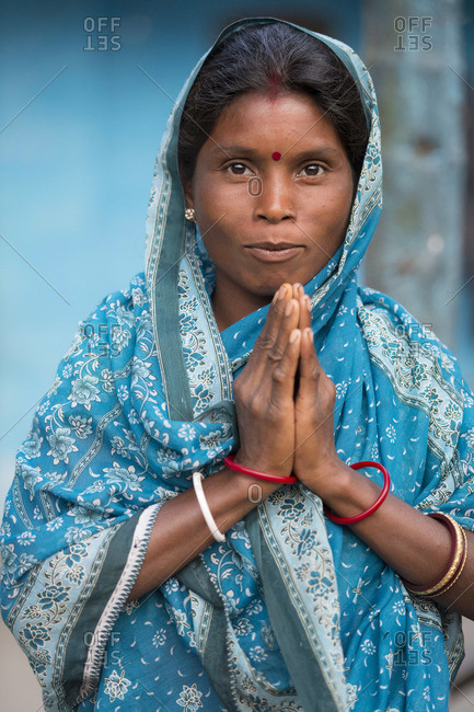 March 28, 2013: Woman greeting with a namaste, India