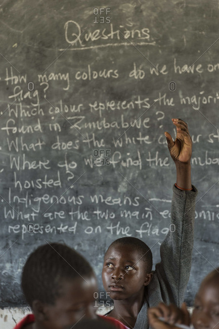 August 26, 2013: Student raising his arm at a school in rural Zimbabwe