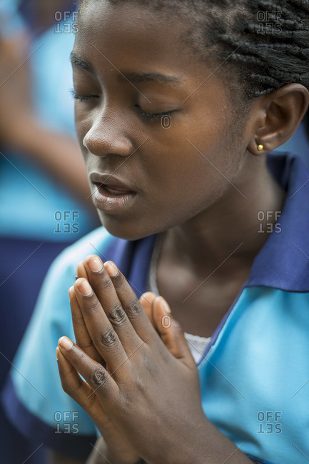 February 11, 2014: A student praying before school near Accra, Ghana