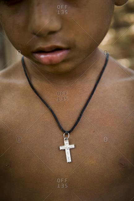 Young Christian boy wearing a cross in Pakistan