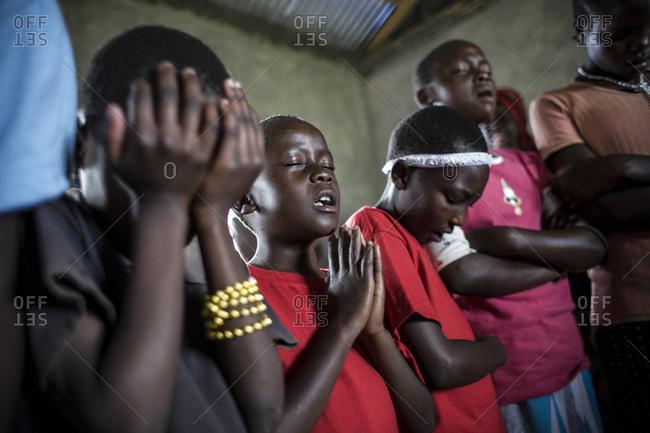 Orphans pray and worship early in the morning, Kenya