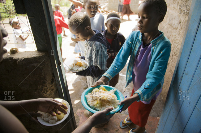 Orphans receive daily meals provided by workers and volunteers, Kenya