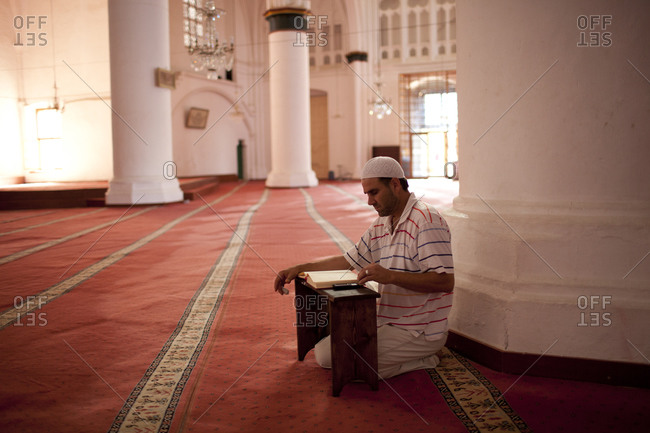 Muslim man reading Quran in the old section of Nicosia, Northern Cyprus