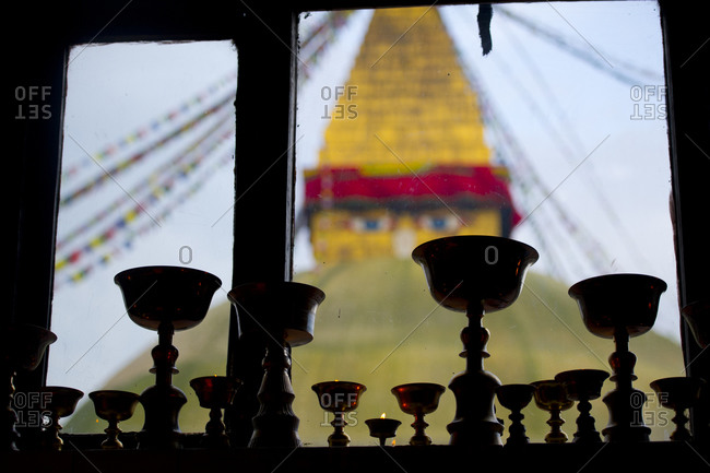 Goblets in a window with the Boudhanath Stupa in the background