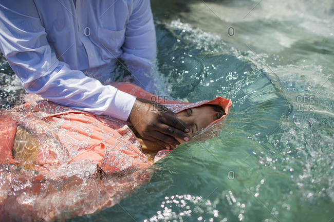 A new believer in the Christian faith is being baptized in India